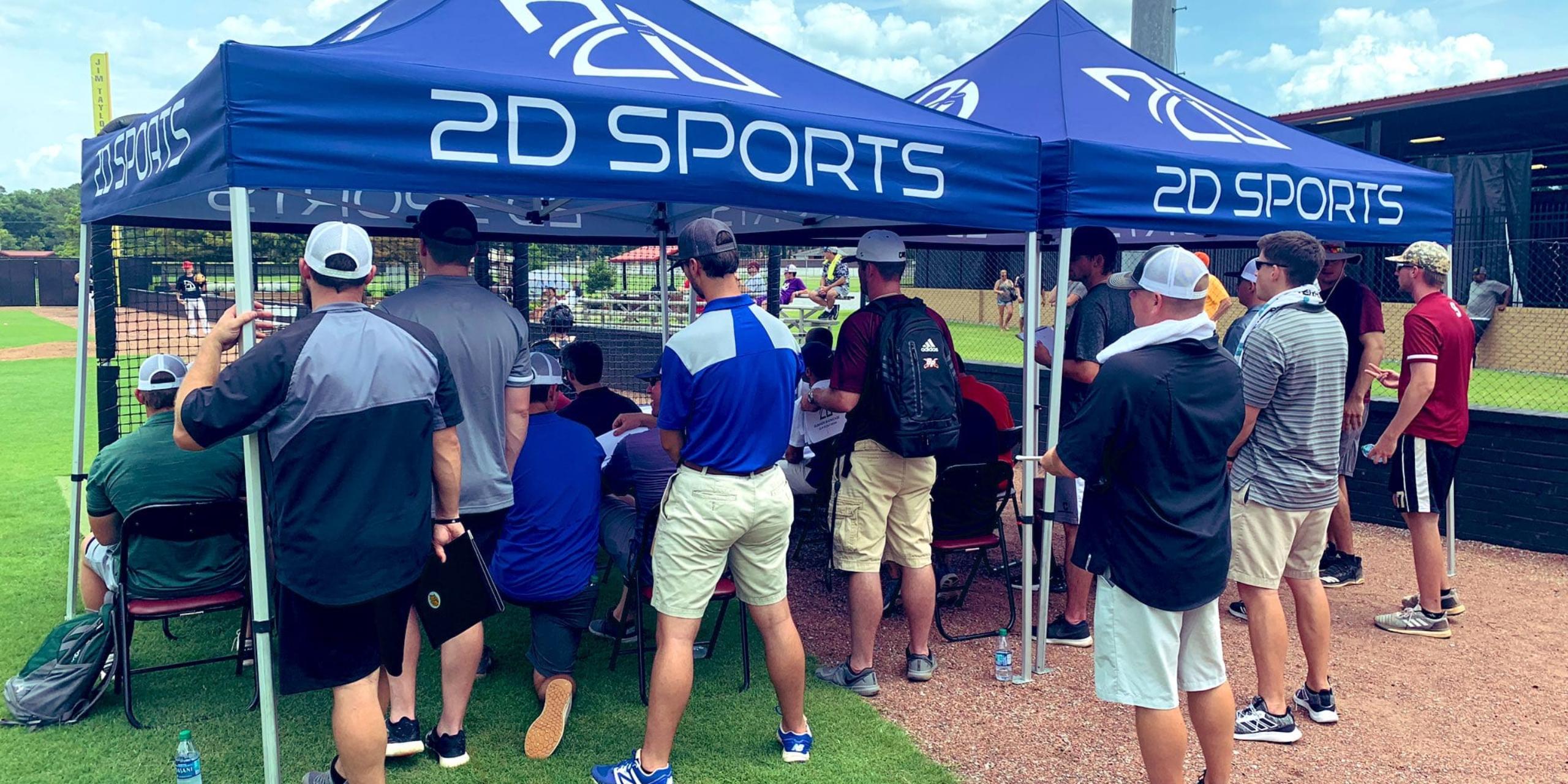 baseball scouts at showcases